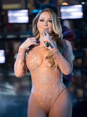 After her earpiece failed well into the third song, Mariah Carey threw in the towel and quit trying to sing to her backing track.