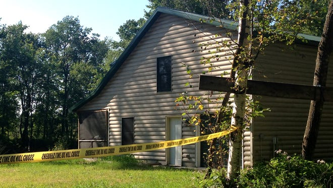 Police tape blocks the entrance to the cabin near the spot where the body of Alayna Ertl, 5, of Watkins, was found, Tuesday, Aug. 23, 2016 in Cass County, Minn.  (Emma Nelson/Star Tribune via AP)