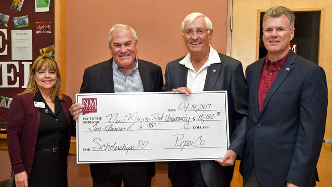 New Mexico State University Chancellor Garrey Carruthers, center right, PepsiCo. Senior Director Food Service David Depoy, center left, Chief Operating Officer of University Advancement Tina Byford, left, and Dean of the College of Business Jim Hoffman pose during a PepsiCo. check presentation ceremony in Corbett Student Center.