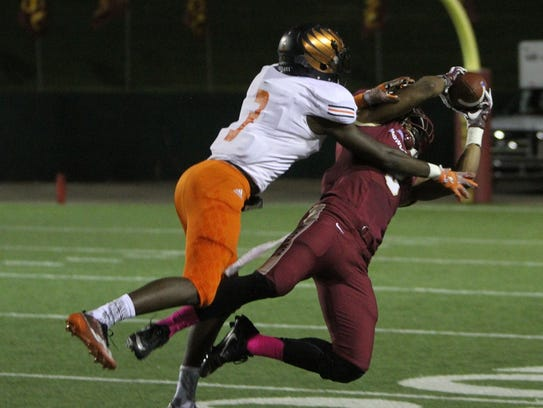 Midwestern State's Tyrique Edwards comes down with