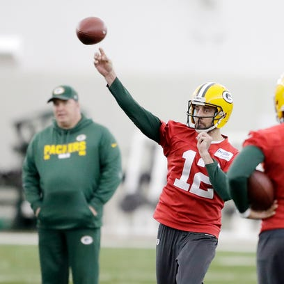 Green Bay Packers quarterback Aaron Rodgers (12) throws