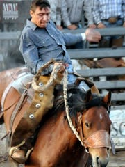 A rider battles to stay in the saddle at the Smokey