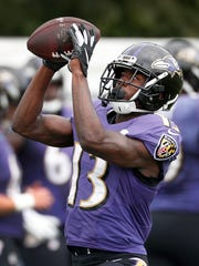 Baltimore Ravens wide receiver John Brown (13) makes a catch during their joint practice at Grand Park in Westfield on Friday Aug 17.