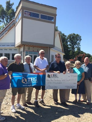 From left are New Hamburg Yacht Club Golf Committee Members Skip Rottkamp, Jack Devine, Charlie Powers and Joseph Corrigan; TEG Federal Credit Union President and CEO Ronald A. Flaherty; Meals on Wheels representatives Chris Contelmo and Millie Milkovich; and TEG FCU Chairman of the Board, Walter V. Behrman Jr.