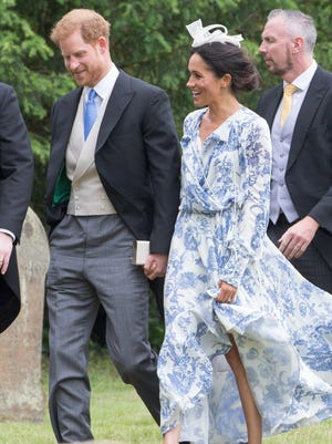 Prince Harry and Duchess Meghan of Sussex arrive for the wedding of Harry's Spencer cousin, Celia McCorquodale, in Stoke Rochford, England, June 16, 2018.