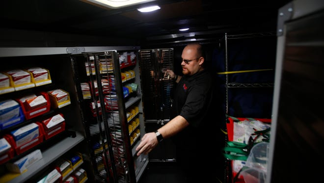 Greg Brown, owner of Safety LLC, shows supplies he sells from inside his mobile training center on Monday at his store in Farmington.