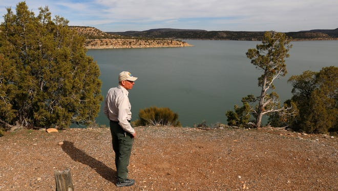 Park Superintendent Gary Skiba looks across the water Friday near the Pinon Loop Campground at Navajo Lake State Park at Navajo Dam. New Mexico officials are considering reducing the amount of territory around the lake that the state is responsible for.