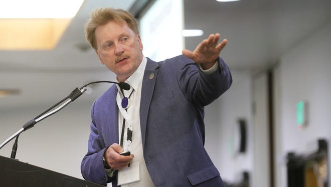 Dennis McQuillan, the New Mexico Environment Department's chief scientist, gives a presentation May 17 on the state's response to the Gold King Mine spill during a conference at San Juan College in Farmington.