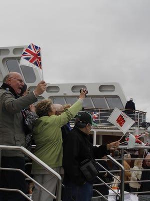 Passengers aboard the QM2 were enjoying the historic moments.