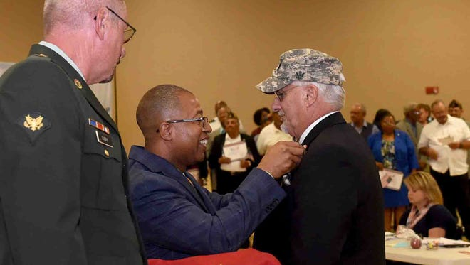 St. Landry Parish School Board member, Huey Wyble, is presented a veterans medal by Patrick Jenkins, school board superintendent, during a recognition of school board employees who are U.S. veterans. The event, sponsored by St.Landry Parish School Board and the LHC Group, was held Thursday prior to the start of the school board's monthly meeting. See more photos on the Daily World Facebook page.