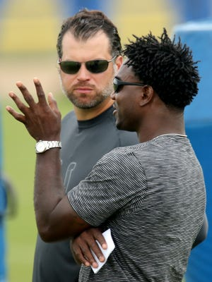 Former Indianapolis Colts running back Edgerrin James talks with general manager Ryan Grigson during practice at training camp, on Saturday, August 9, 2014, in Anderson.