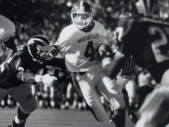 MSU quarterback Dan Enos runs for the Spartans' first