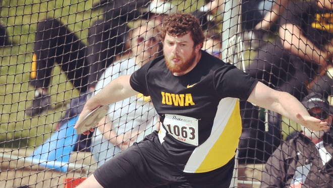 Iowa's Gabe Hull throws in the finals of the discuss at the Drake Relays on Saturday, April 26, 2014, at Drake Stadium in Des Moines, Iowa.