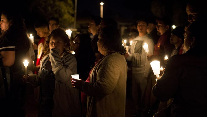 Mourners gather at a memorial for Sarah Monique Castillo-Cornejo in Glendale on Friday, Nov. 25, 2016. Police say Castillo was killed driving the wrong way on Interstate 10 early Friday morning after she collided head-on with a Greyhound bus. No one else was killed.