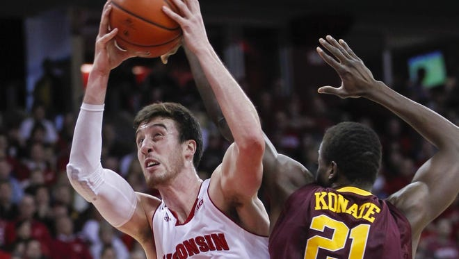 Wisconsin's Frank Kaminsky (44) shoots against Minnesota's Bakary Konate during the second half of an NCAA college basketball game Saturday, Feb. 21, 2015, in Madison, Wis. Kaminsky had a game-high 21 points in Wisconsin's 63-53 win.