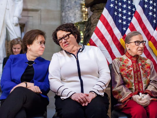 From left: Supreme Court Justices Elena Kagan, Sonia Sotomayor and Ruth Bader Ginsburg participate in a reception at the Capitol  in 2015.