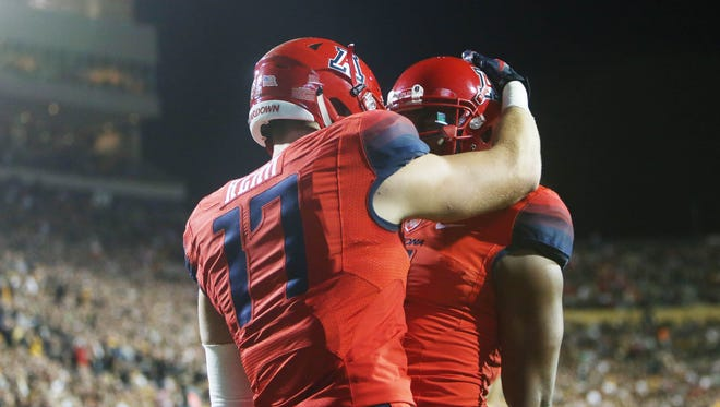 Arizona Wildcats tight end Josh Kern (17) celebrates with wide receiver Cayleb Jones (right) after catching a touchdown pass during the first half against the Colorado Buffaloes at Folsom Field.