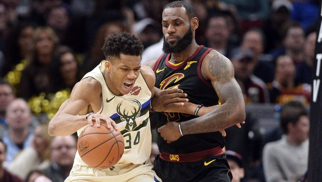 Mar 19, 2018; Cleveland, OH, USA; Milwaukee Bucks forward Giannis Antetokounmpo (34) works against Cleveland Cavaliers forward LeBron James (23) during the second half at Quicken Loans Arena. Mandatory Credit: Ken Blaze-USA TODAY Sports