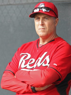 Reds manager Bryan Price observes a bullpen session at spring training.