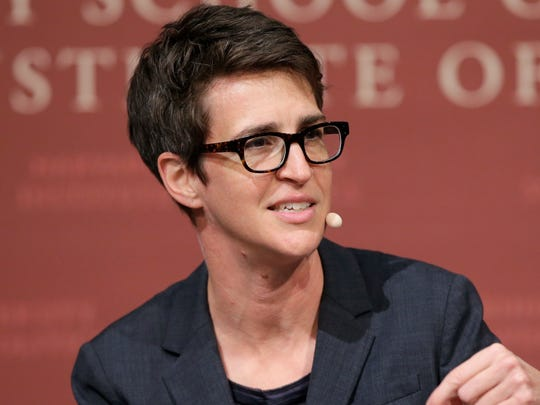 Westlake Legal Group 636650592210131321-AP-Rachel-Maddow-Chokes-Up One America News sues Rachel Maddow for $10 million for dubbing network 'Russian propaganda'