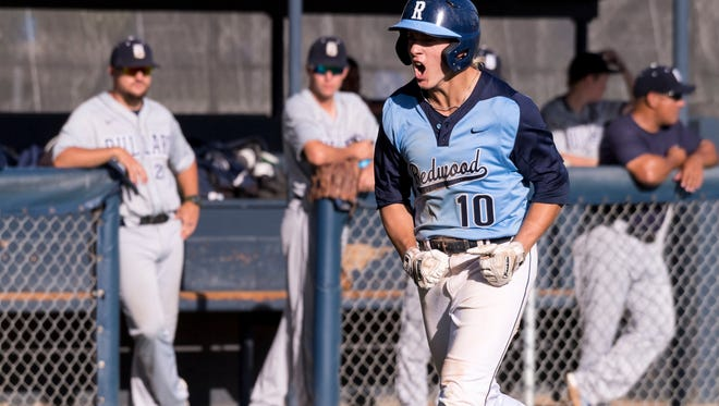 Redwood's Hunter Bryan celebrates his home run to tie the game 4-4 against Bullard in a Central Section Division I first-round high school playoff game on Tuesday, May 15, 2018.