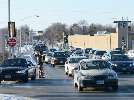 Traffic backs up on South Webster Avenue in Allouez as authorities work the scene of a multiple-vehicle crash to the west on Wisconsin 172 on Wednesday morning.