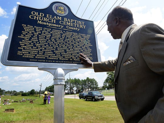 Foster Ware reads the historic marker in the Old Elam Baptist Church Cemetery in Montgomery, Ala. after it was unveiled on Sunday August 24, 2014