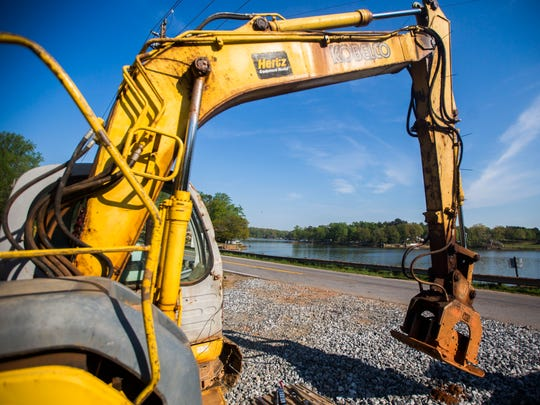 Contractors hired by Anderson County finish state-ordered repairs on the Broadway Lake dam on Thursday.