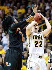 Iowa senior Samantha Logic takes a shot against Miami
