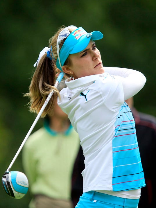 Lexi Thompson tees-off from the 12th hole during the LPGA Championship at the Monroe Golf Club, Thursday, Aug. 14, 2014 in Pittsford, N.Y. (AP Photo/The Buffalo News, Harry Scull Jr)  TV OUT; MAGS OUT; MANDATORY CREDIT; BATAVIA DAILY NEWS OUT; DUNKIRK OBSERVER OUT; JAMESTOWN POST-JOURNAL OUT; LOCKPORT UNION-SUN JOURNAL OUT; NIAGARA GAZETTE OUT; OLEAN TIMES-HERALD OUT; SALAMANCA PRESS OUT; TONAWANDA NEWS OUT