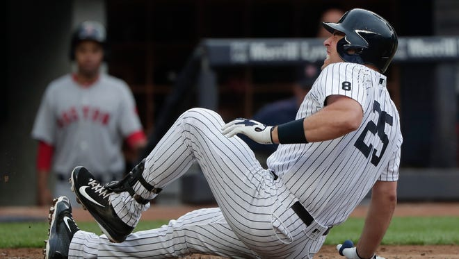 New York Yankees' Mark Teixeira (25) grimaces after fouling the ball off his ankle during the fourth inning of a baseball game against the Boston Red Sox, Saturday, July 16, 2016, in New York.