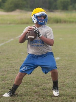 CrosLex's Joey Johnston drops back for a pass as they do passing drill.