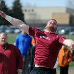 Roosevelt's Jack Lembcke competes in the shot put at the Rich Greeno city track meet Tuesday at McEneaney Field. Lembcke set meet records in the shot put and discus.
