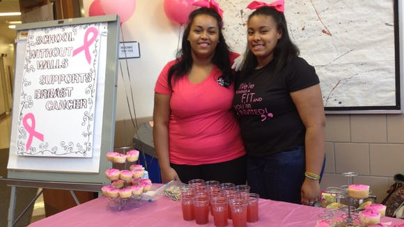 """Alexis Hernandez and Dimine Hickenbottom selling """"Cupcakes for Cancer."""""""