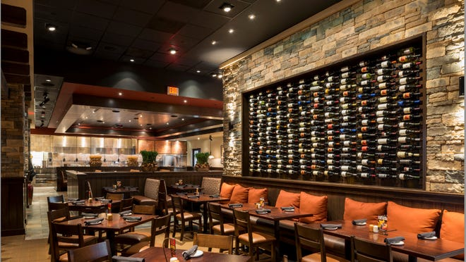 """Firebirds Wood Fired Grill describes its style as """"polished casual. The chain is opening its first Greater Cincinnati location in the Deerfield Towne Center in the summer of 2015."""