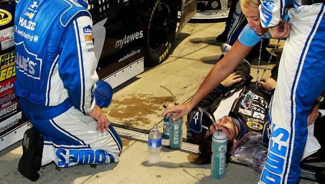 Jimmie Johnson lays next to his car after finishing the Federated Auto Parts 400 at Richmond International Raceway.