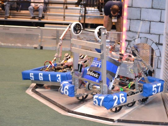 The STEM FIRST Robotics FRC Team ThunderDogs #5613 robot attacks a castle during the teams Flagstaff, Arizona, competition recently.