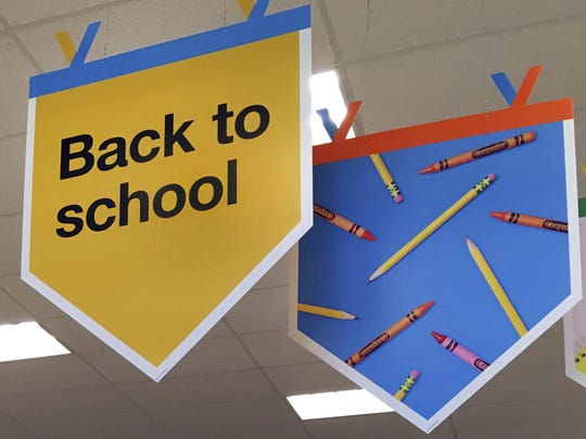 "In this July 31, 2018 photo, ""back to school"" signage hangs in a store in Methuen, Mass."