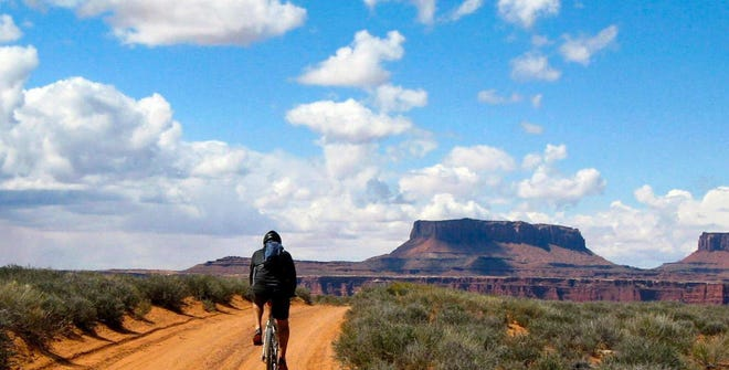 Brandon Andress mountain bikes in Canyonlands National Park in Utah.