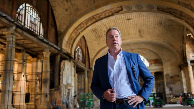 Ford Executive Chairman Bill Ford Jr. stands in the lobby of the former Michigan Central Depot train station in Detroit, June 14, 2018. Ford Motor Co.'s purchase of the building and several others in Corktown will allow the automaker to build a new mobility corridor along Michigan Avenue, from Corktown to its facilities in Dearborn, Willow Run and the University of Michigan campus.