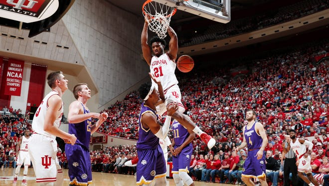 Indiana Hoosiers forward Freddie McSwain (21) dunks against Tennessee Tech Golden Eagles forward Courtney Alexander II (22) during the first half at Assembly Hall.
