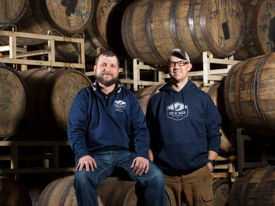Central Waters Brewing co-owners Anello Mollica (left) and Paul Graham take a moment among the barrels on Dec. 9, 2016. The Amherst brewery has made a name for itself with its barrel-aged brews.   MARK  HOFFMAN/MHOFFMAN@JOURNALSENTINEL.COM