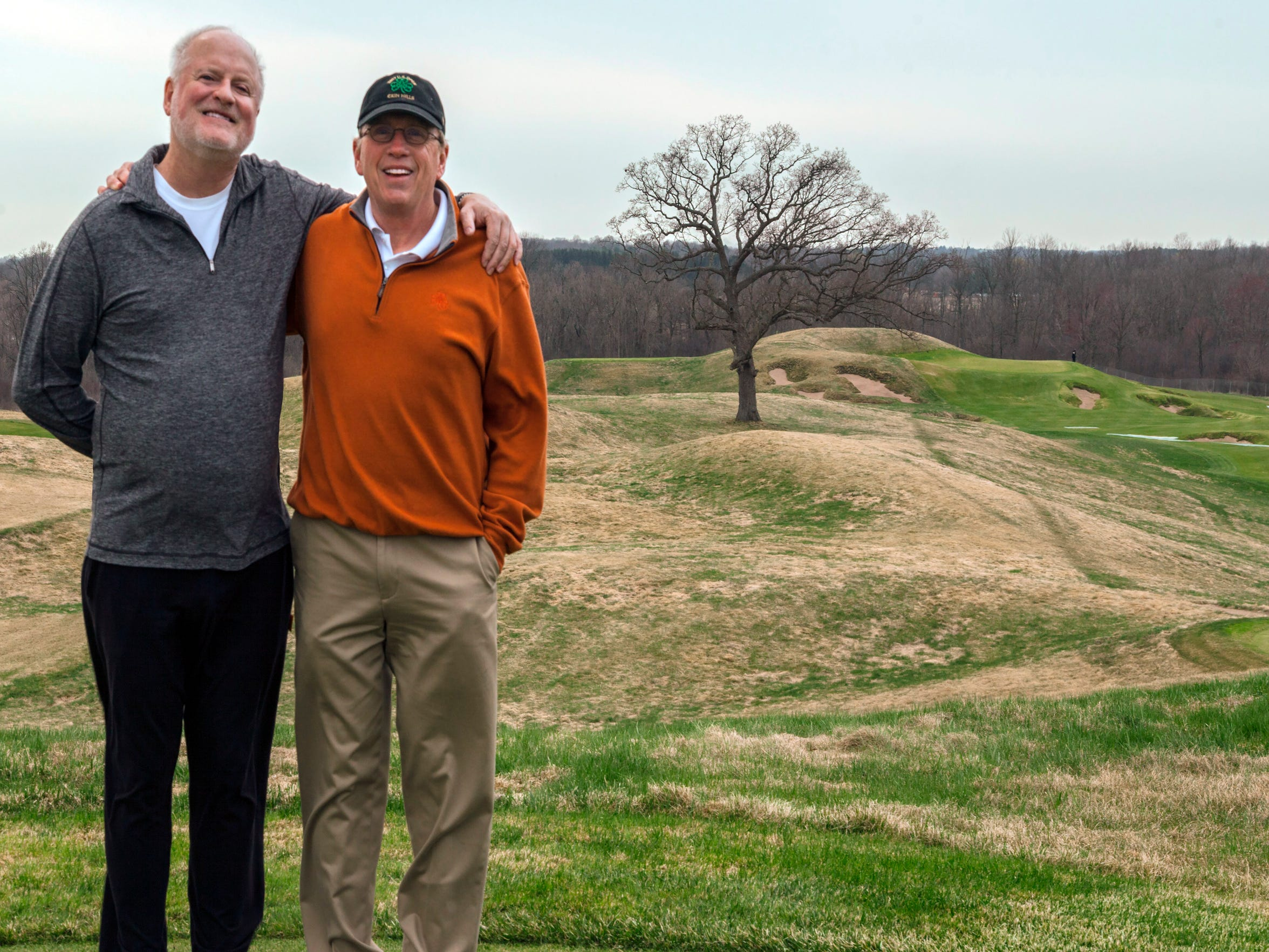David Rasmussen (left), a Milwaukee-area golf instructor, and Paul Hundley (right), a professional photographer, pose for a photo at Erin Hills. The pair made an early bid to buy the land to build a golf course.