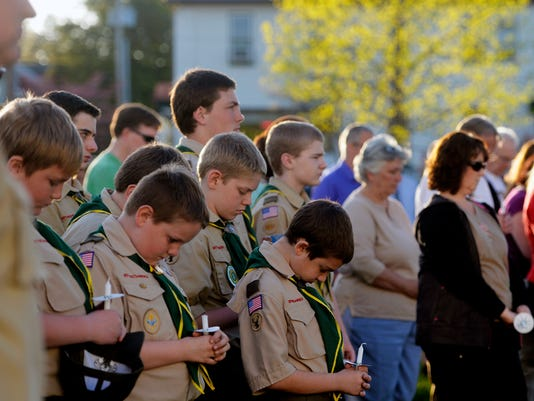 Members of New Freedom's Boy Scout Troop 24 bow their heads in prayer during a vigil held for the victims of an attempted murder-suicide earlier in the day on Wednesday, April 19, 2015, in New Freedom. Jennifer Liszewski, 36, allegedly shot her 11-year-old son before turning the gun on herself. Both are in critical condition and are being held in separate hospitals. More than 100 people gathered in Freedom Green for the vigil, at which local pastors led people in prayer and encouraged individual prayer. Chris Dunn Ñ Daily Record/Sunday News