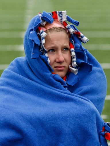 Waukesha West pole vaulter Jayde Wollenberg hides from the cold, damp and generally miserable weather at the Heimark Northstar Classic in Waukesha on Saturday, April 30, 2016.