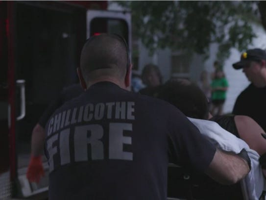 Chillicothe Fire Department personnel roll a man on