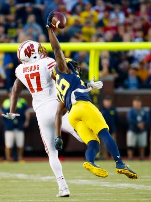 Oct 1, 2016; Ann Arbor, MI, USA; Michigan Wolverines cornerback Jourdan Lewis intercepts a pass intended for Wisconsin Badgers wide receiver George Rushing in the fourth quarter at Michigan Stadium.
