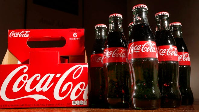 Bottles of Coca-Cola.