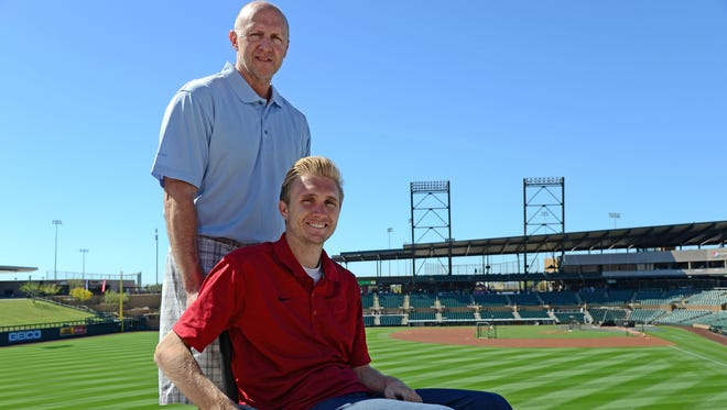 Four years after he was paralyzed in a college game, Cory Hahn, with help from his father Dale, works in the scouting department of the Arizona Diamondbacks.