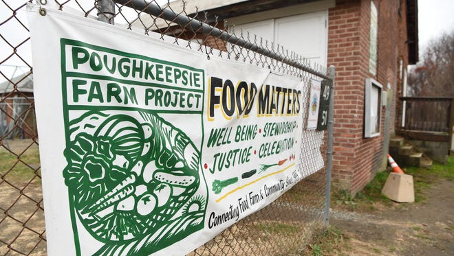 A banner outside the Poughkeepsie Farm Project office at Vassar Farm Lane in the town of Poughkeepsie.